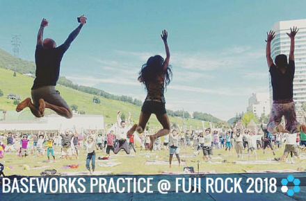 Patrick Oancia, Satoko Horie and Junko Shimada jumping into the air on the pyramid garden stage at Fuji Rock after leading a Baseworks movement Practice at Fuji Rock Festival in 2016